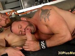 Horny gay bear eats delicious dick