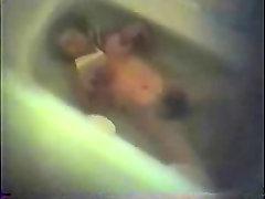 My hairy mum caught masturbating in bath tube. Hidden cam