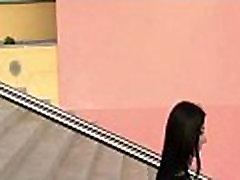FTV Brunette woman flashing pussy in a public place on stairs