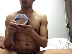 Tape gagged asian guy with black duct tape