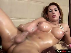 Doll with balls is fingering her ass in closeup and oil tugs