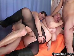 Busty granny in stockings swallows 2 cocks