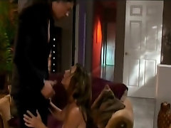 Sexy femme fatale is fucked from behind against armchair in living room