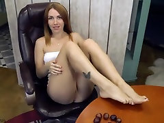Red-haired girl playing with pussy and squirt