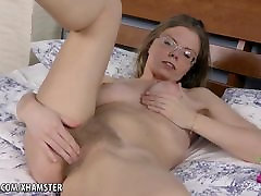 Blonde babe Ekaterina rubs her hairy pussy on the bed