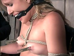 Sluttishly looking blonde Sasha Heart is tied up and punished in the bdsm room