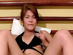 Smoking ladyboy strips and masturbates