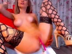 Leggy blonde masturbates in stockings and panties