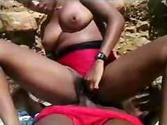 Horny ebony beauty is having nice banging on the hot beach