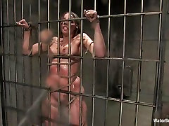 Convict bitch Delilah Strong tied to the bars and taking a good hosing