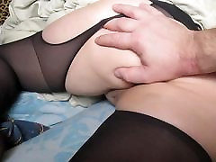 Touching ass and pussy in crotchless pantyhose in bed