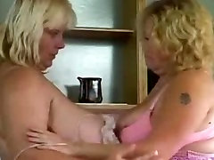 Big breasts babe licking pussy and squizing huge melons