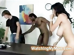 Horny busty MILF makes her son watch her fucking a black cock