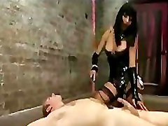 Tranny in latex gives anal fingering on guy