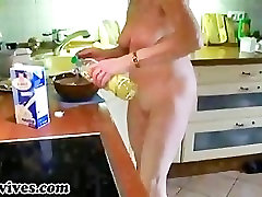Sexy mature wife preparing some food naked