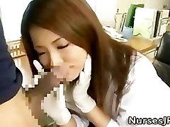Asian nurse slut gives a handjob