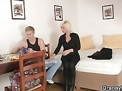 Mature blonde takes it from behind