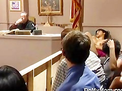 Asian MILF toys ass in courtroom scene.