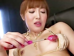 Asian gal Mami gives herself a hard orgasm from the powerful sex toys
