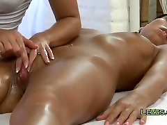 Brunette gets pussy oiled and massaged