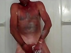 A mature amateur guy taking a long soapy shower