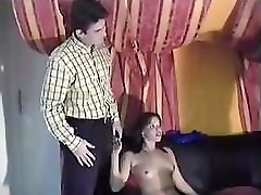 Vintage video with a hot brunette getting fucked in both holes