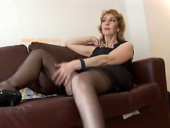 Mature English blonde babe in stockings upskirt tease