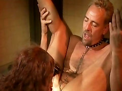 Black blowing a older man in a weird BDSM outfit