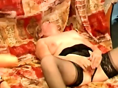 Granny rubs her hairy cunt