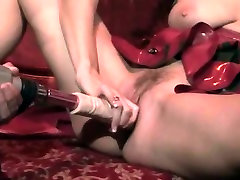 Couple In Latex Uses a Dildo Drill!