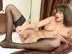 Cinthia Doll masturbates in sexy black stockings