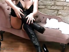 Sexy College girl in leather lingerie plays with whip