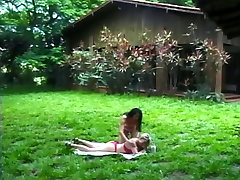 Two sexy lesbians masturbating and licking pussy outside