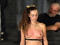 Master Len restrains his tattooed slave girl and tortures her tits in basement