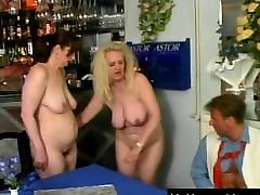 Two mature sluts share a large cock