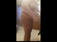 bbw wife squeezing into her black girdle, big tits, belly,
